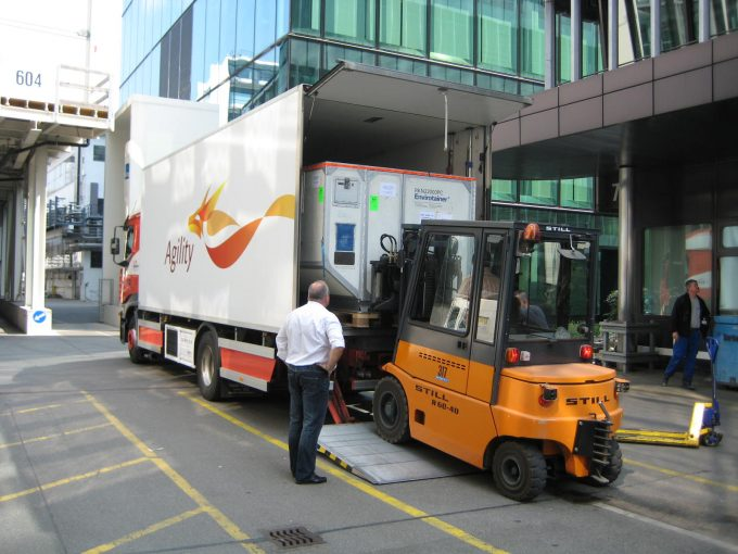 A specialist team moves an Envirotainer at the EuroAirport in Basel, Switzerland, where Agility runs a Pharma Competence Centre