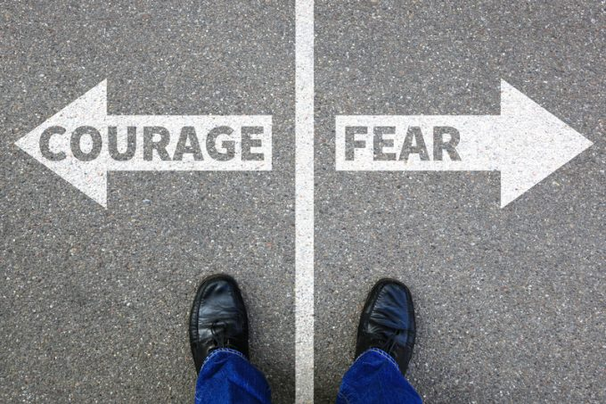Courage and fear risk safety future strength strong business concept danger