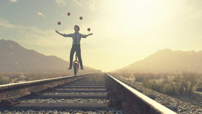 Juggler is balancing on railroad