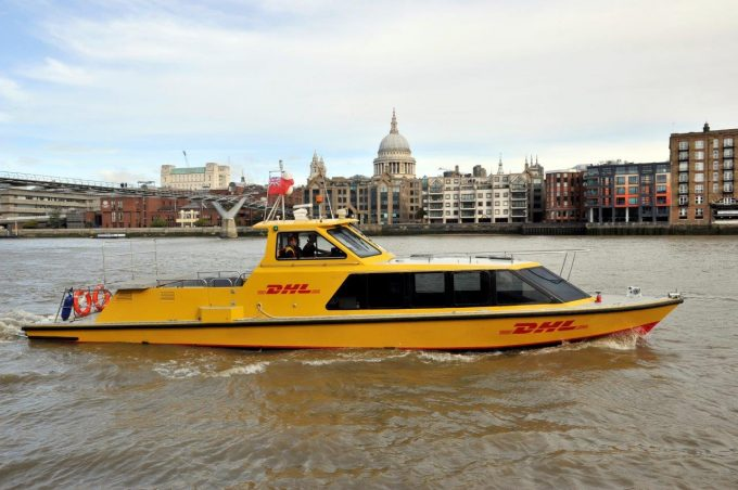DHL Express riverboa_r with St Pauls