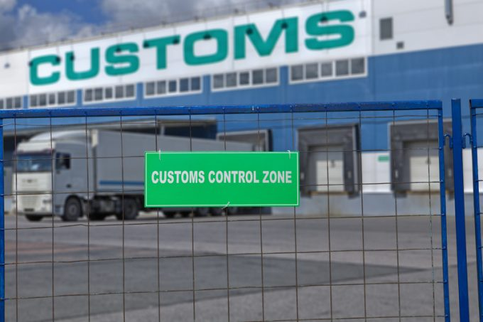 Customs control space with truck near warehouse storage of goods