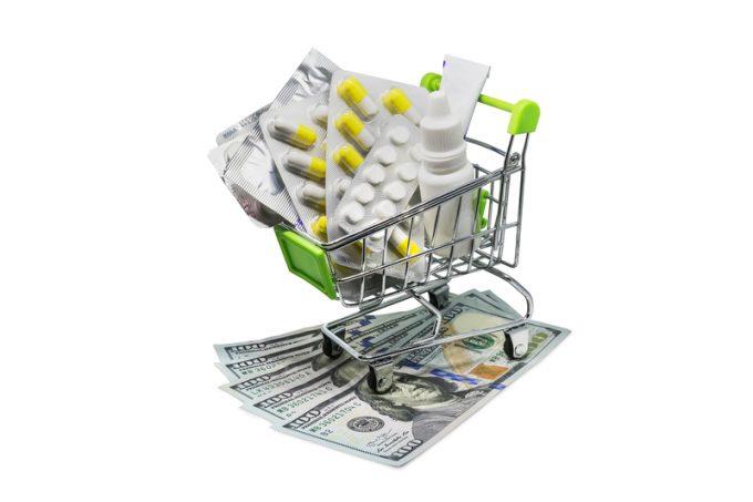 Prescription drugs on money representing rising health care costs.