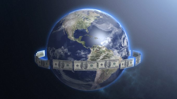 Dollar bills around Earth planet, money ruling world, cash flow, global trade