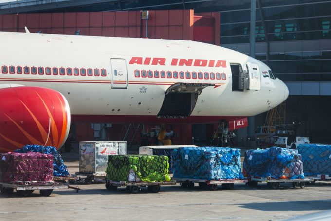 Plane of Air India airline stands on loading at the airport of D