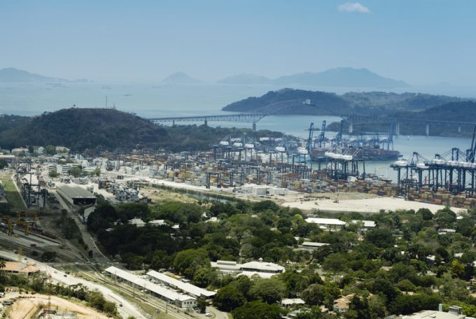 Aerial View Of Panama Industrial Port On The Atlantic Side. Large Harbor Cranes At The Commercial Dock In Panama City