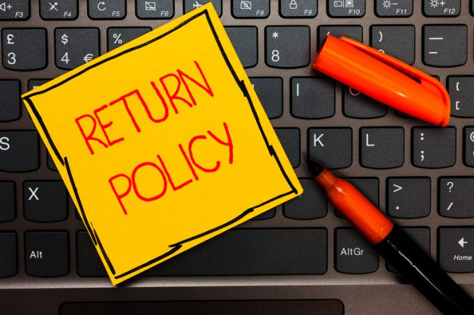 Writing note showing Return Policy. Business photo showcasing Tax Reimbursement Retail Terms and Conditions on Purchase Yellow paper keyboard Inspiration communicate ideas orange markers.