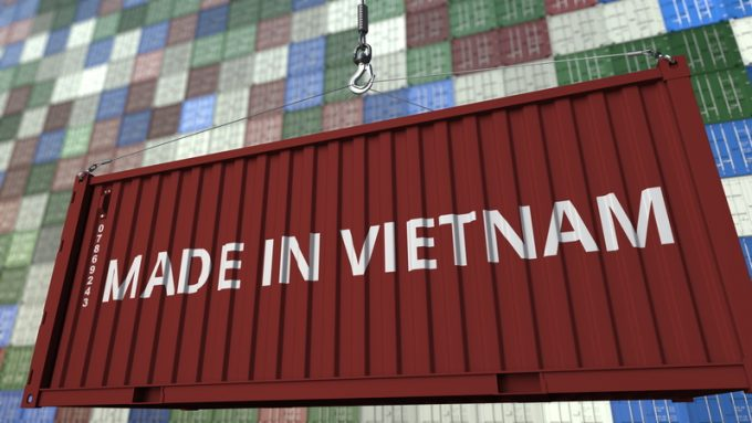 Loading container with MADE IN VIETNAM caption. Vietnamese import or export related 3D rendering