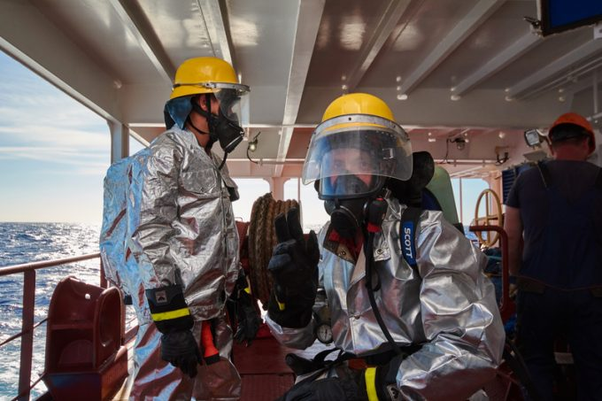 At sea - September 2018: International ship's crew performing monthly fire drill exercise.