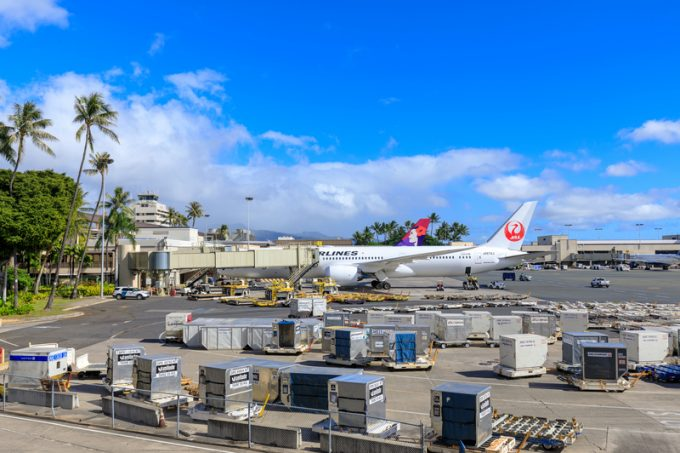 Jet airplanes of Hawaiian Airlines and Japan Airlines at Honolulu International Airport