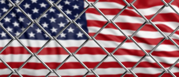 US of America flag behind a steel wire mesh. 3d illustration