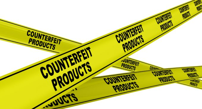 Counterfeit products. Yellow warning tapes