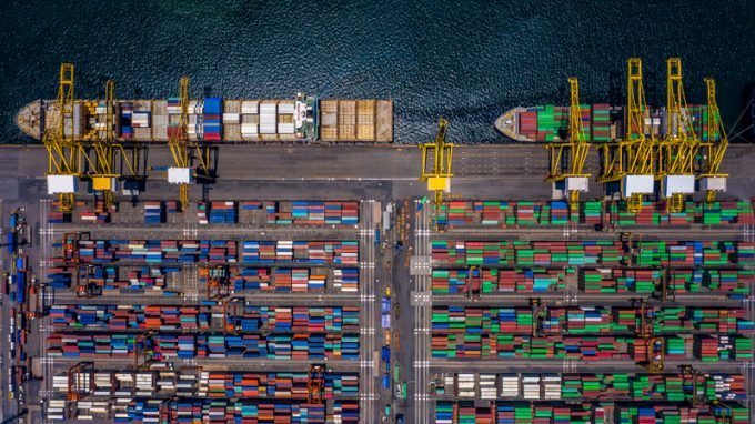 Aerial top view container cargo ship unloading in import export