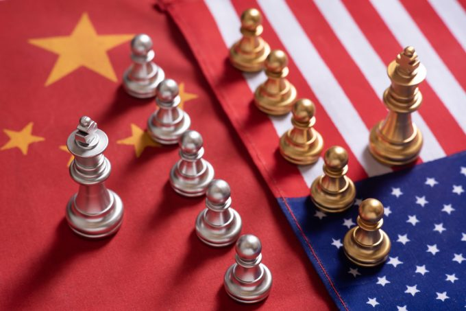 Chess game. Two team stand confront each other on China and USA national flags. Trade war concept.