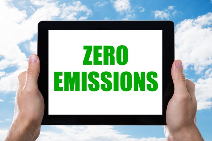 Man Holding Digital Tablet With Zero Emissions Text On Screen