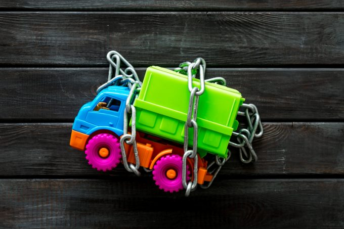 Chain around the truck for car protection concept on wooden background top view