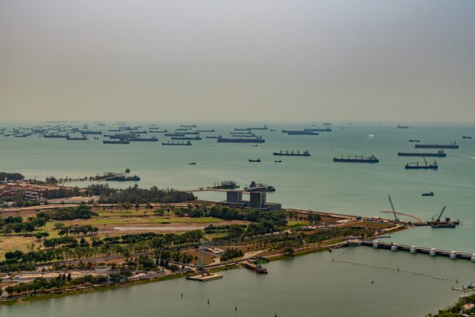 Birds eye, tens of ships anchored in the Strait, Singapore.