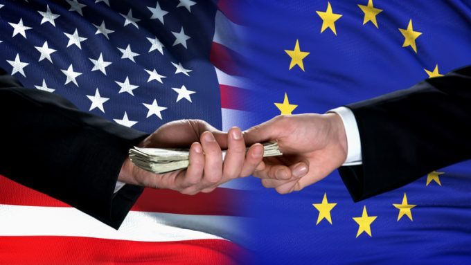 USA and EU officials exchanging money, flag background, international trade