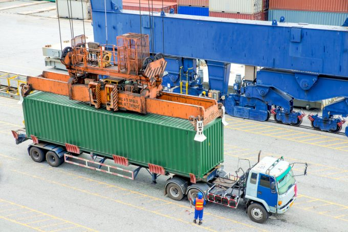 Container truck waiting for loading container box to Cargo ship
