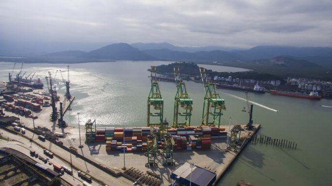 Aerial view Port of Santos - Container ship being loaded at the