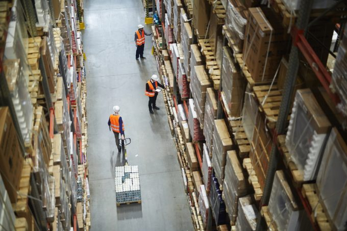 Movers and Loaders Working in Warehouse