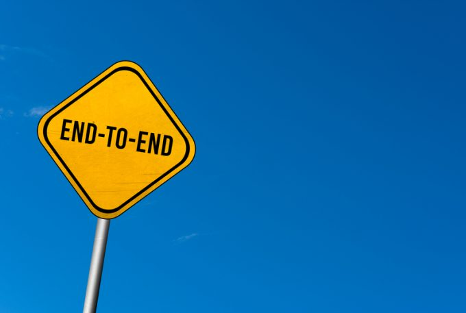 End-to-End - yellow sign with blue sky
