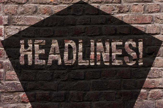 Handwriting text Headlines. Concept meaning Heading at the top of an article in newspaper Brick Wall art like Graffiti motivational call written on the wall.