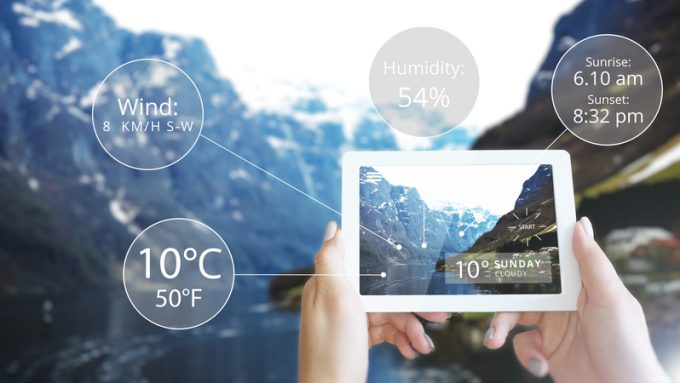Augmented Reality information technology displayed tablet in mountain - Weather
