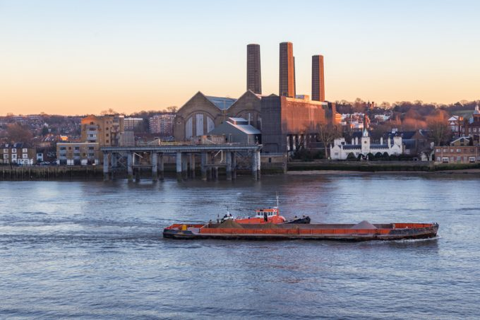 Cargo ship on the River Thames at the Greenwich power station.