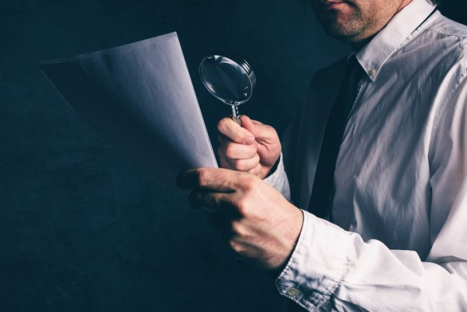 Tax inspector doing financial auditing, businessman reading cont