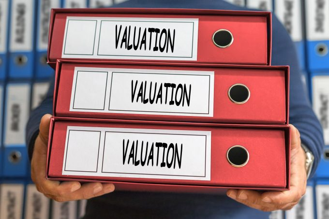 Valuation concept words. Folder concept. Ring binders.