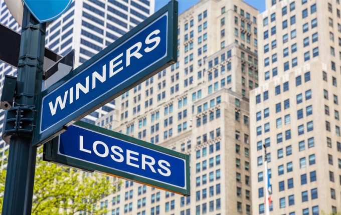 Winners losers crossroads street sign. Highrise buildings background,