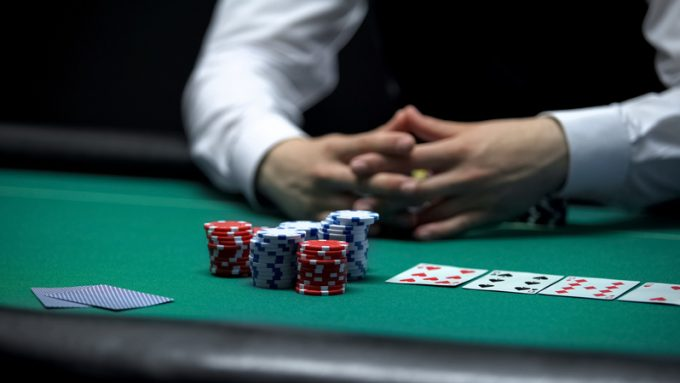 Casino client poker player making bet with all chips, chance to win at gambling